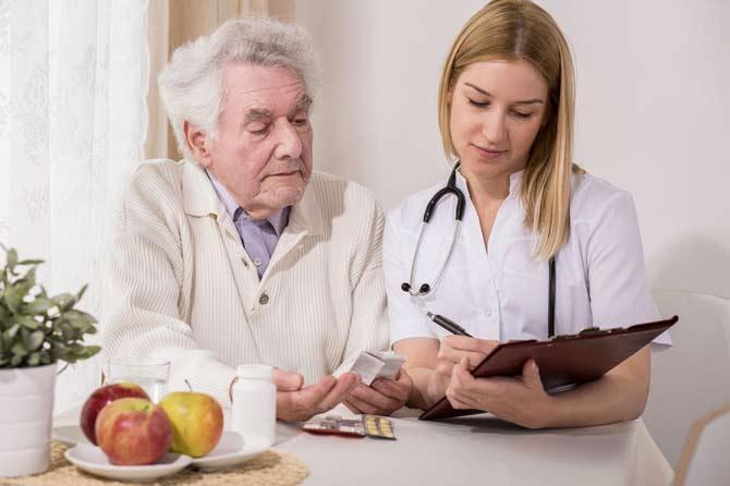 Senior man consulting with nurse