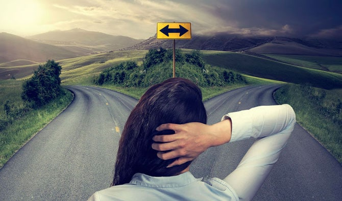 Woman standing at crossroads, wanting direction