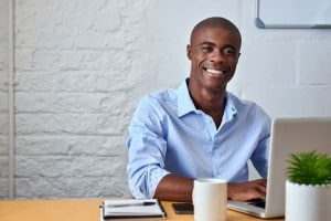African businessman in casual dress working at desk