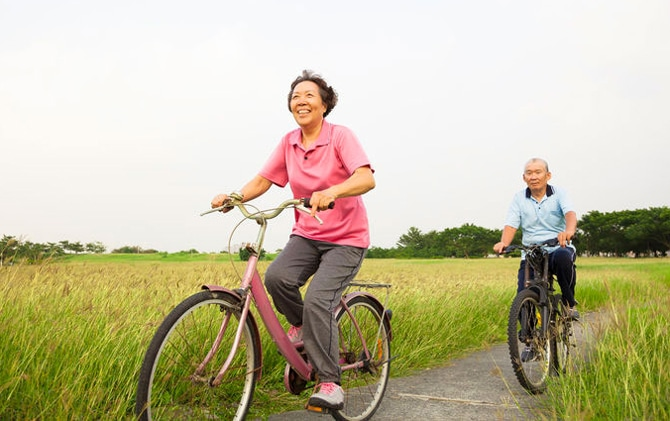 HAppy asian couple riding bicycles