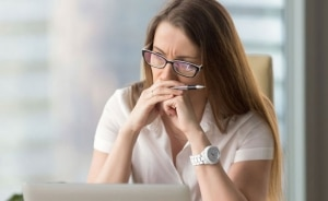 Female executive with long hair and glasses