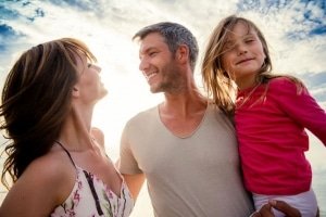 Happy young couple with daughter