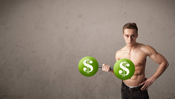 Young man with dumbells painted with money signs