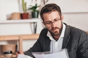 Businessman examining paperwork