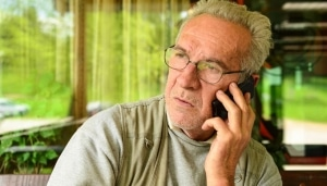 Man talking on phone, troubled look on his face