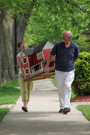 seniors carrying house
