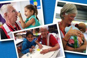 senior red cross volunteers working with children