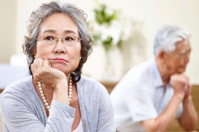 Senior Asian couple looking frustrated